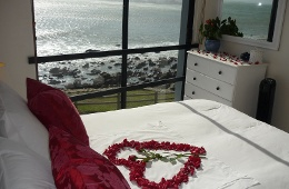 Romantic view of Cottage bedroom onto the waves