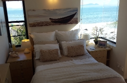 Hear the splash of the waves int he romantic Seaside Suite bedroom with sea views all around