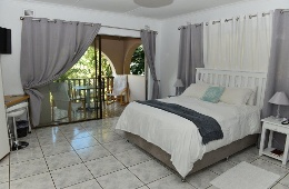 Sea facing room with double bed and balcony.