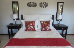 Single bedroom with queen bed and ensuite shower